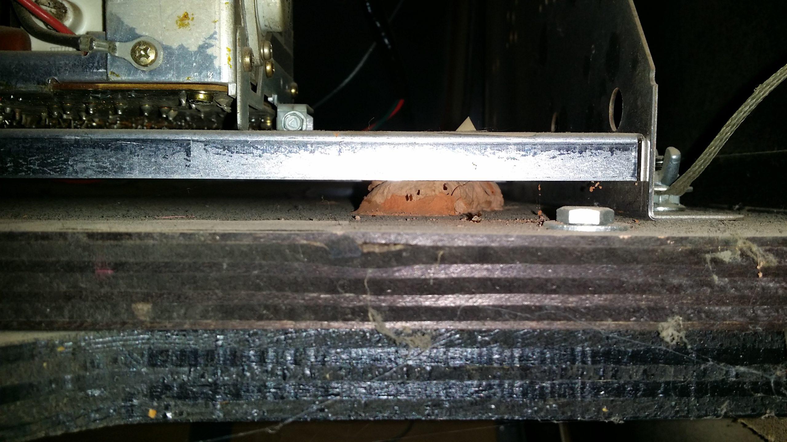 wasp nest under monitor