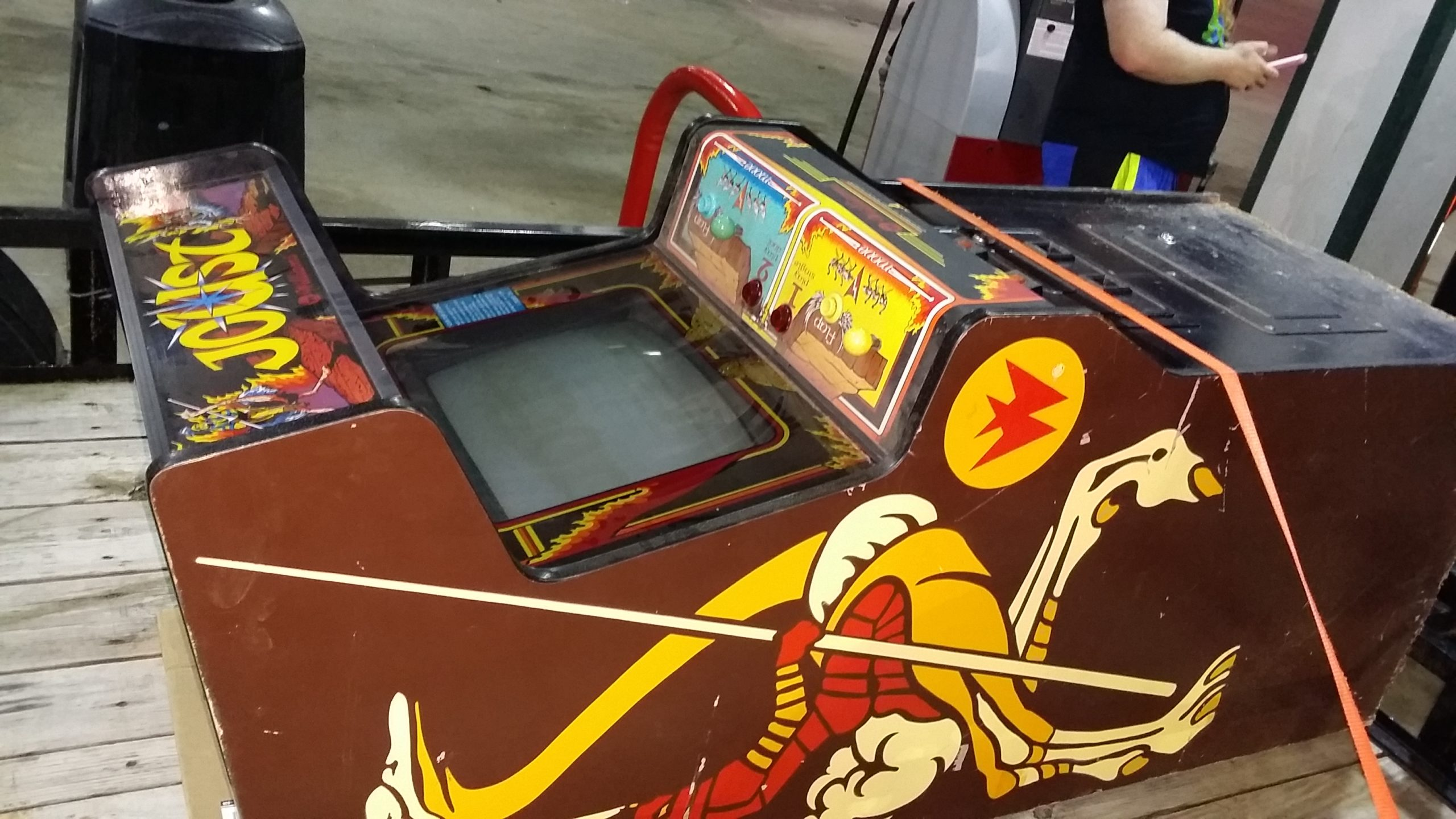 Joust cabinet strapped to a trailer bed