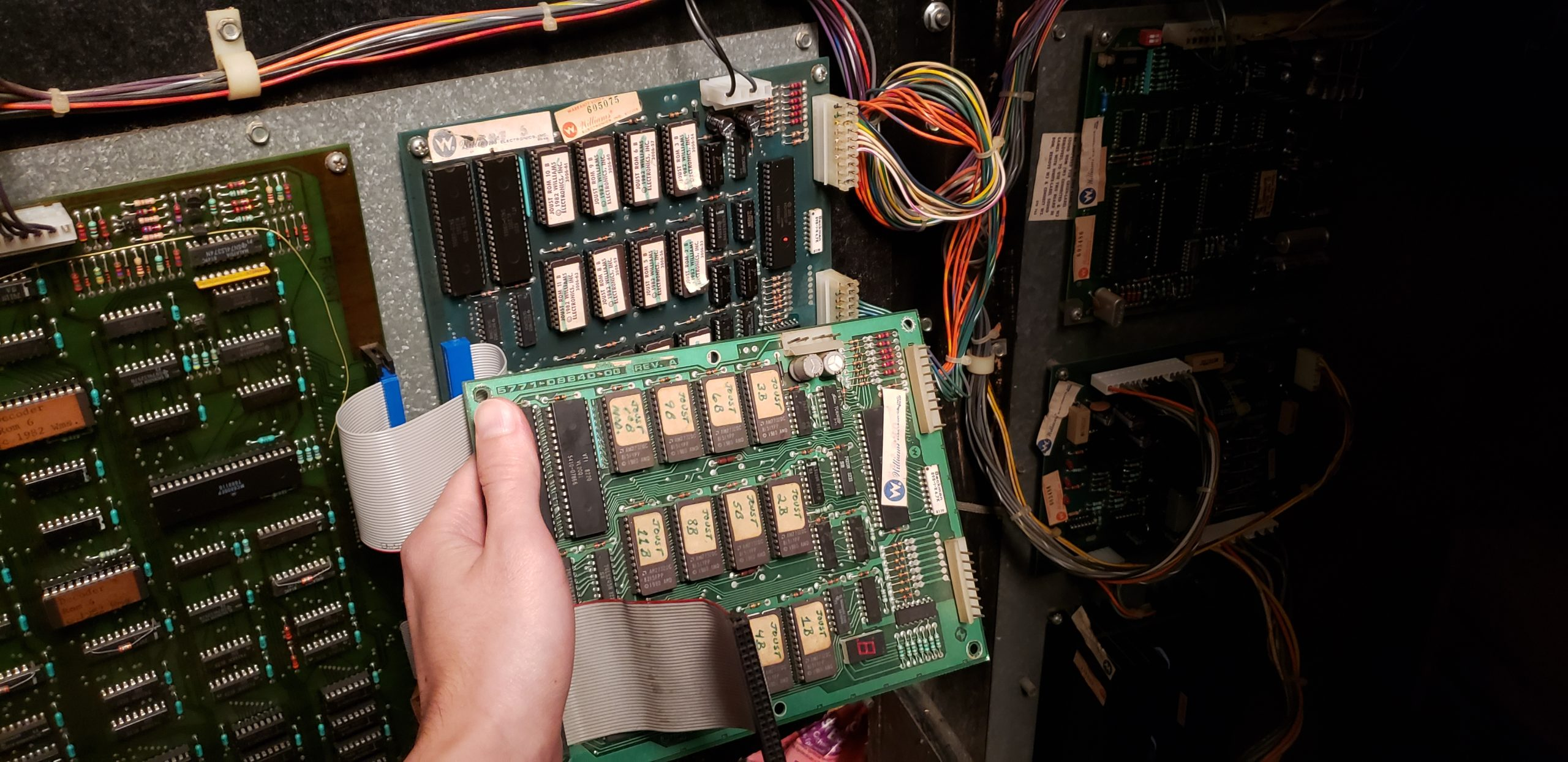 holding replacement ROM board in front of old ROM board