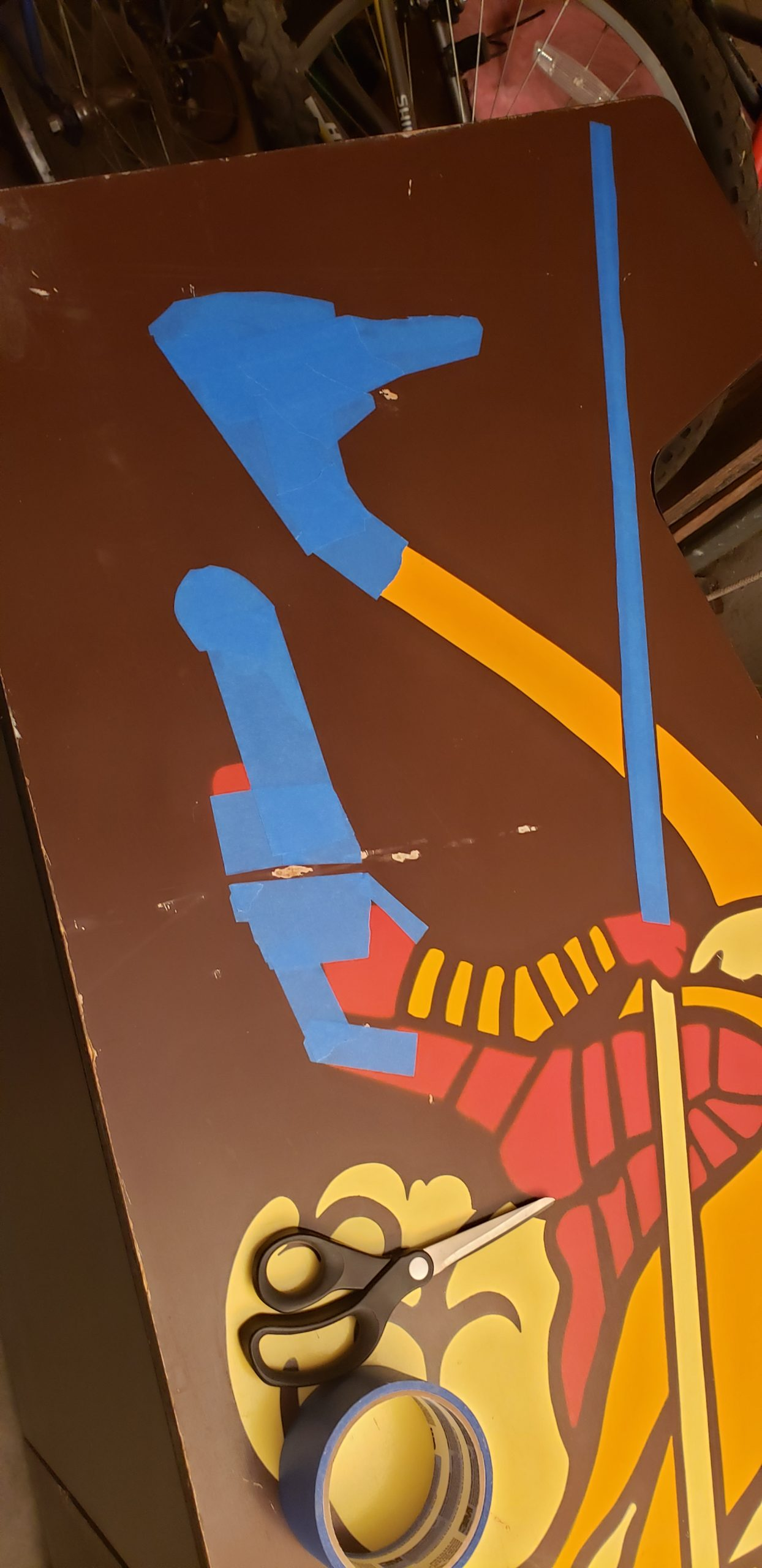 left side art partially masked